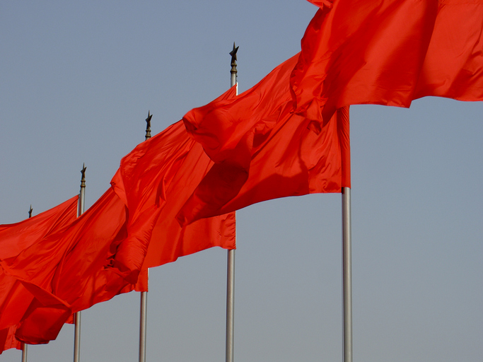 red flags flying at Tiananmen Square
